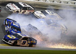 Chase Elliott (9), Ricky Stenhouse Jr. (17), Brad Keselowski (2), Kyle Larson (42), Ty Dillon (13) and Alex Bowman (88) wreck in Turn 3 during the NASCAR Daytona 500 auto race at Daytona International Speedway, Sunday, Feb. 17, 2019, in Daytona Beach, Fla. (AP Photo/Gary McCullough)