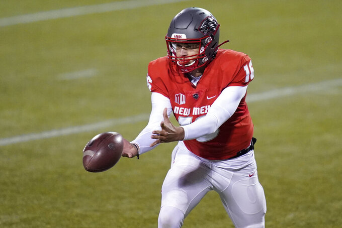 New Mexico quarterback Connor Genal (16) tosses the ball during the first half of the team's NCAA college football game against Wyoming on Saturday, Dec. 5, 2020, in Las Vegas. (AP Photo/John Locher)