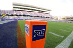 FILE - In this Saturday, Sept. 4, 2021, file photo, a Big 12 Conference logo is displayed on a goal line pylon before Duquesne played TCU in an NCAA college football game, in Fort Worth, Texas. The Big 12 has extended membership invitations to BYU, UCF, Cincinnati and Houston to join the Power Five league. That comes in advance of the league losing Oklahoma and Texas to the Southeastern Conference. (AP Photo/Ron Jenkins, File)