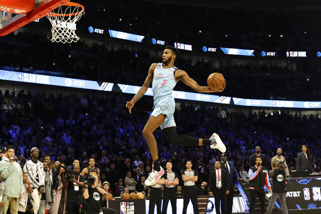 Miami Heat's Derrick Jones Jr. heads to the basket during the NBA All-Star slam dunk contest in Chicago, Saturday, Feb. 15, 2020. (AP Photo/Nam Y. Huh)