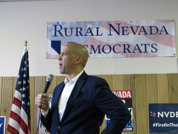 Sen. Cory Booker, D-N.J., talks about his presidential campaign during a speech to about 100 people on Friday, April 19, 2019, at the Douglas County Democratic headquarters in Minden, Nev. Booker became the first candidate running for president in 2020 to make a campaign stop in a rural part of the early caucus state. (AP Photo/Scott Sonner)