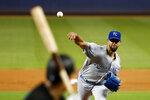 Kansas City Royals' Jorge Lopez, right, pitches to Miami Marlins' Starlin Castro during the first inning of a baseball game Friday, Sept. 6, 2019, in Miami. (AP Photo/Wilfredo Lee)