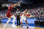 Belmont's Michael Benkert (24) passes around Temple's J.P. Moorman II (4) during the first half of a First Four game of the NCAA college basketball tournament, Tuesday, March 19, 2019, in Dayton, Ohio. (AP Photo/John Minchillo)