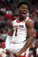 Texas Tech's Terrence Shannon Jr. (1) celebrates a dunk during the first half of an NCAA college basketball game against Bethune-Cookman, Saturday, Nov. 9, 2019, in Lubbock, Texas. (Sam Grenadier/Lubbock Avalanche-Journal via AP)