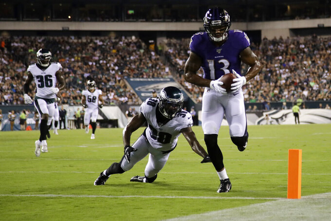 Baltimore Ravens' Michael Floyd (13) scores a touchdown past Philadelphia Eagles' Jeremiah McKinnon (38) during the first half of a preseason NFL football game Thursday, Aug. 22, 2019, in Philadelphia. (AP Photo/Matt Rourke)