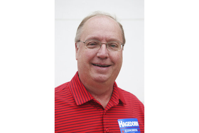 FILE - In this June 10, 2018 file photo, Minnesota 1st District congressional candidate Jim Hagedorn poses for a photo before a parade in Waterville, Minn. Minnesota freshman Republican Rep. Hagedorn said Wednesday, Feb. 19, 2020, he is being treated for cancer but still plans to run for re-election this year. (AP Photo/Jim Mone, File)