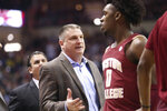 Boston College's head coach Jim Christian, left, talks with CJ Felder during a time out in the first half of an NCAA college basketball game with Florida State Saturday, March 7 2020, in Tallahassee, Fla. Florida State won 80-62. (AP Photo/Steve Cannon)