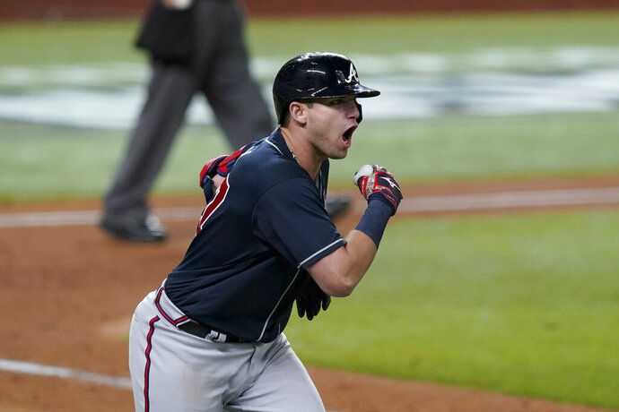 Atlanta Braves' Austin Riley celebrates a run home against the Los Angeles Dodgers during the ninth inning in Game 1 of a baseball National League Championship Series Monday, Oct. 12, 2020, in Arlington, Texas. (AP Photo/Eric Gay)