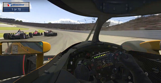 This image taken from video provided by iRacing IndyCar, shows the view of driver Sage Karam during the First Responder 175 presented by GMR virtual IndyCar auto race at the Indianapolis Motor Speedway, Saturday, May 2, 2020, in Indianapolis, Ind. (iRacing IndyCar via AP)