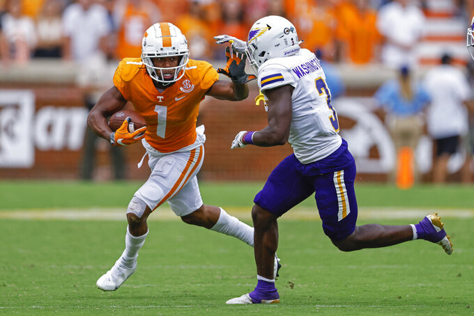 Tennessee wide receiver Velus Jones Jr. (1) escapes the grasp go Tennessee Tech linebacker Xavier Washington (3) during the second half of an NCAA college football game Saturday, Sept. 18, 2021, in Knoxville, Tenn. Tennessee won 56-0. (AP Photo/Wade Payne)
