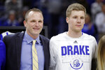 Drake head coach Darian DeVries stands with guard Brady Ellingson, right, during senior day ceremonies before of an NCAA college basketball game against Indiana State, Wednesday, Feb. 27, 2019, in Des Moines, Iowa. Drake has surpassed 20 wins for just the second time in 48 years behind a steady new coach in DeVries, a senior who has blossomed into a player of the year candidate in Nick McGlynn and former Iowa reserve Ellingson, who is hitting three-point shots at a near-record pace. (AP Photo/Charlie Neibergall)