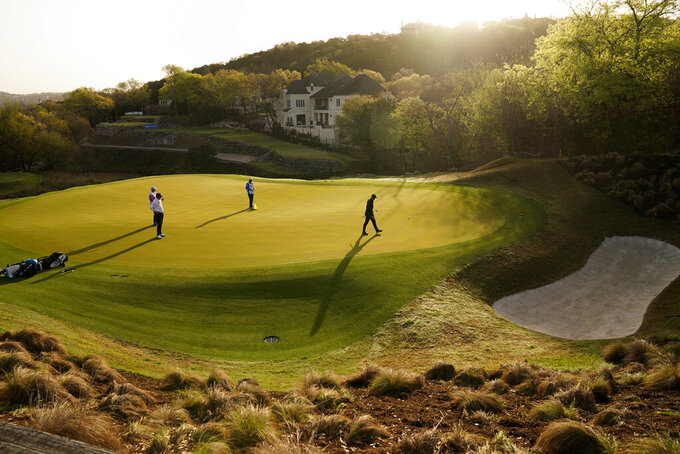 Rory McIlroy, right, misses a birdie putt on the fourth green, with Ian Poulter, of England, at left, during a first round match at the Dell Technologies Match Play Championship golf tournament Wednesday, March 24, 2021, in Austin, Texas. (AP Photo/David J. Phillip)