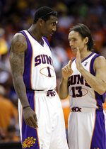 FILE - In this May 23, 2010, file photo, Phoenix Suns forward Amare Stoudemire, left, and guard Steve Nash talk during Game 3 of the NBA basketball Western Conference finals against the Los Angeles Lakers in Phoenix. Mike D'Antoni and Stoudemire are joining Nash's coaching staff, bringing a glimpse of the old Phoenix Suns to Brooklyn. Nash hired his old coach and pick-and-roll partner as assistants Friday, Oct. 30, 2020, filling out his staff for his rookie season as an NBA coach. (AP Photo/Matt York, File)