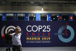 A participant takes a selfie ahead of the Climate Summit COP25 in Madrid, Spain, Friday, Nov. 29, 2019. The Climate Summit COP25 runs between 2 Dec. until 13 Dec in Madrid. (AP Photo/Manu Fernandez)
