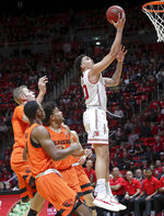 Utah forward Timmy Allen, right, gets in front of Oregon State on a breakaway and lays up the ball to the basket during the second half of an NCAA college basketball game, Saturday, Feb. 2, 2019, in Salt Lake City. (AP Photo/Chris Nicoll)