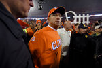 Clemson head coach Dabo Swinney gathers in the middle of the field after an NCAA college football game against South Carolina Saturday, Nov. 24, 2018, in Clemson, S.C. Clemson won 56-35. (AP Photo/Richard Shiro)