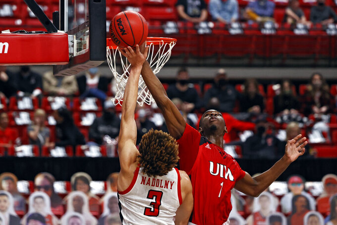 Incarnate Word's Bradley Akhile (1) blocks the layup attempt by Texas Tech's Clarence Nadolny (3) during the second half of an NCAA college basketball game Tuesday, Dec. 29, 2020, in Lubbock, Texas. (AP Photo/Brad Tollefson)