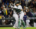Oakland Athletics closing pitcher Jesus Luzardo and catcher Sean Murphy hug after the 1-0 win over the Seattle Mariners in a baseball game, Saturday, Sept. 28, 2019, in Seattle. (AP Photo/John Froschauer)