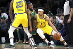 Golden State Warriors guard Damion Lee (1) drives Boston Celtics guard Kemba Walker into a pick set by Warriors forward Marquese Chriss (32) during the second quarter of an NBA basketball game Thursday, Jan. 30, 2020, in Boston. (AP Photo/Elise Amendola)