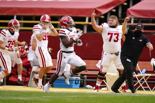 Louisiana-Lafayette running back Chris Smith, center, returns a kickoff 95-yards for a touchdown during the first half of an NCAA college football game against Iowa State, Saturday, Sept. 12, 2020, in Ames, Iowa. (AP Photo/Charlie Neibergall)