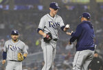 Tampa Bay Rays relief pitcher Ryan Yarbrough, center, is removed uring the fifth inning of the team's baseball game against the New York Yankees on Tuesday, June 18, 2019, in New York. (AP Photo/Frank Franklin II)
