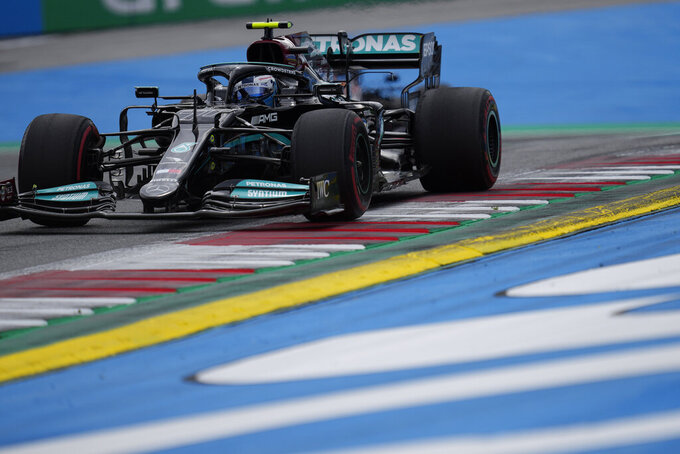 Mercedes driver Valtteri Bottas of Finland steers his car during the second practice at the Red Bull Ring racetrack in Spielberg, Austria, Friday, June 25, 2021. The Styrian Formula One Grand Prix will be held on Sunday, June 27, 2021. (AP Photo/Darko Vojinovic)
