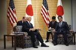 U.S. Vice President Mike Pence, left, meets Japanese Prime Minister Shinzo Abe, right, at Abe's official residence in Tokyo Tuesday, Nov. 13, 2018. (AP Photo/Eugene Hoshiko)