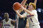 Arizona guard Nico Mannion (1) drives against Washington State center Volodymyr Markovetskyy during the second half of an NCAA college basketball game Thursday, March 5, 2020, in Tucson, Ariz. Arizona won 83-62. (AP Photo/Rick Scuteri)