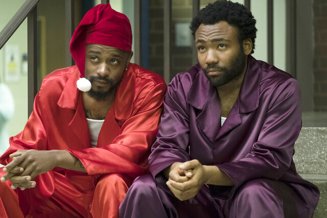 This image released by FX shows Lakeith Stanfield, left, and Donald Glover in a scene from