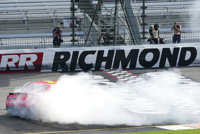 Justin Allgaier (7) does a burnout as he celebrates after winning a NASCAR Xfinity Series auto race Saturday, Sept. 12, 2020, in Richmond, Va. Allgaier swept the two days of racing in the Xfinity Series. (AP Photo/Steve Helber)