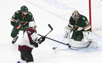 Minnesota Wild's goalie Alex Stalock, right, stops a shot as he and Minnesota Wild's Jonas Brodin, top left, of Sweden defends against Colorado Avalanche's Nazem Kadri in the first period of an NHL hockey game Thursday, Nov. 21, 2019, in St. Paul, Minn. (AP Photo/Jim Mone)