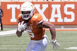 FILE - In this April 24, 2021, file photo, Texas running back Bijan Robinson (5) carries the ball during the final half of their spring NCAA college football game in Austin, Texas. (AP Photo/Michael Thomas, File)