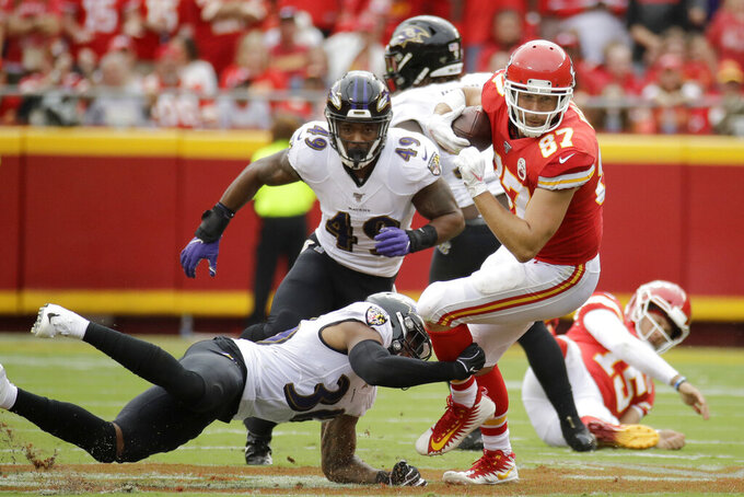 Kansas City Chiefs tight end Travis Kelce (87) is tackled by Baltimore Ravens linebacker Chris Board (49) and safety Chuck Clark (36) during the first half of an NFL football game in Kansas City, Mo., Sunday, Sept. 22, 2019. (AP Photo/Charlie Riedel)