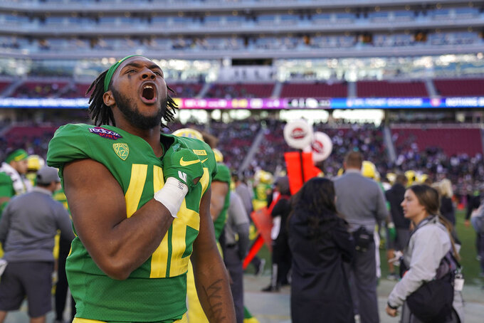 Oregon linebacker Isaiah Pitre (48) celebrates with fans after a victory against Michigan State in the Redbox Bowl NCAA college football game Monday, Dec. 31, 2018, in Santa Clara, Calif. (AP Photo/Tony Avelar)