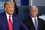 Vice President Mike Pence, right, listens as President Donald Trump, left, makes a statement from the briefing room at the White House in Washington, Tuesday, Nov. 24, 2020. (AP Photo/Susan Walsh)