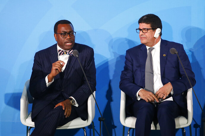 FILE - In this Monday, Sept. 23, 2019 file photo, African Development Bank President Akinwumi Adesina, left, is joined by Masen President Mustapha Bakkoury as he addresses the Climate Action Summit in the United Nations General Assembly, at U.N. headquarters. Africa shouldn't have to beg for help in addressing climate change, the president of the African Development Bank said Tuesday, Feb. 11, 2020, adding that polluting global powers
