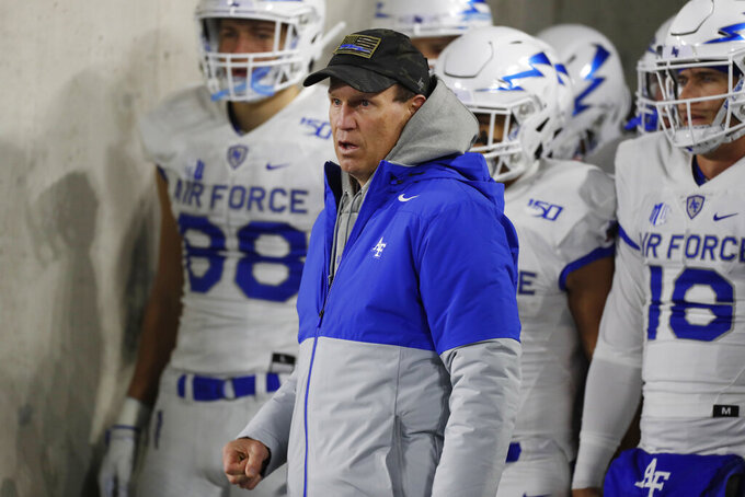 Air Force head coach Troy Calhoun leads his players onto the field for the first half of an NCAA football game against Colorado State Saturday, Nov. 16, 2019 in Fort Collins, Colo. (AP Photo/David Zalubowski)