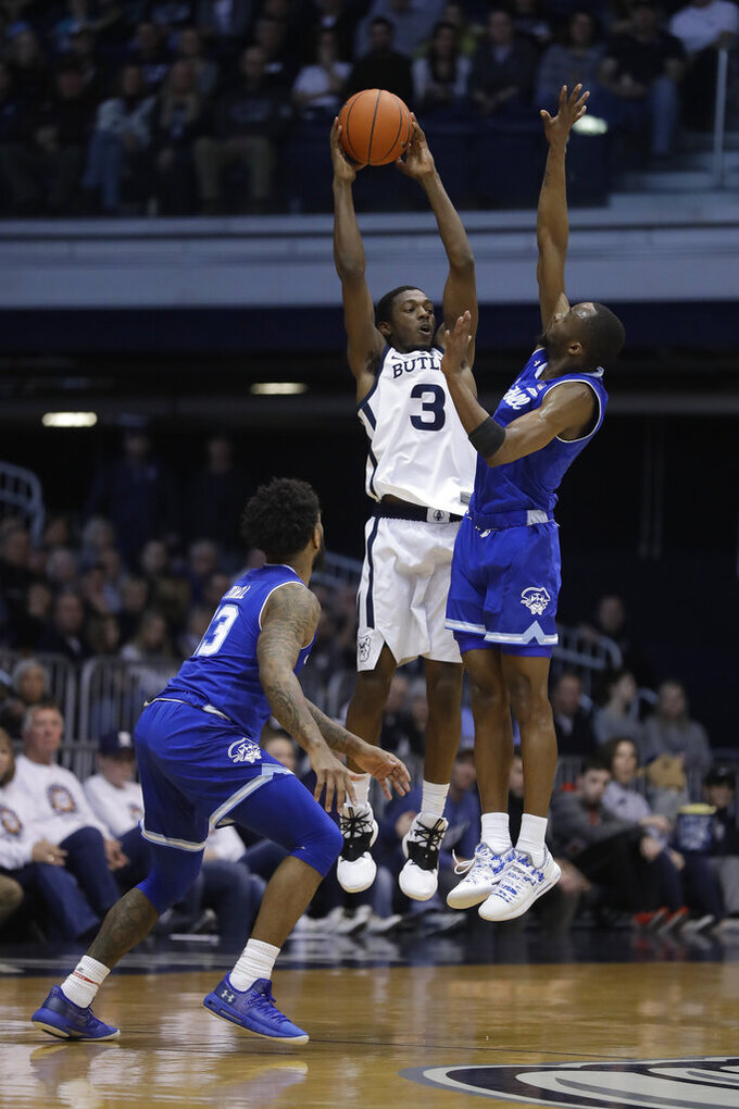 Butler's Kamar Baldwin (3) makes a pass against Seton Hall's Myles Powell, left, and Quincy McKnight during the first half of an NCAA college basketball game, Saturday, Feb. 2, 2019, in Indianapolis. (AP Photo/Darron Cummings)