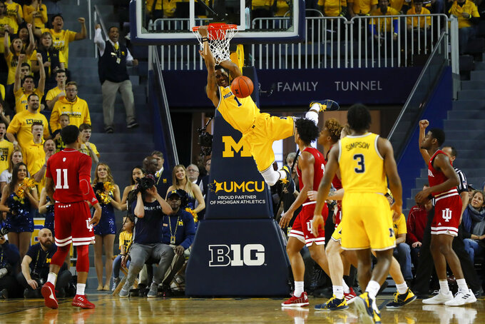Michigan guard Charles Matthews (1) dunks in the first half of an NCAA college basketball game against Indiana in Ann Arbor, Mich., Sunday, Jan. 6, 2019. (AP Photo/Paul Sancya)