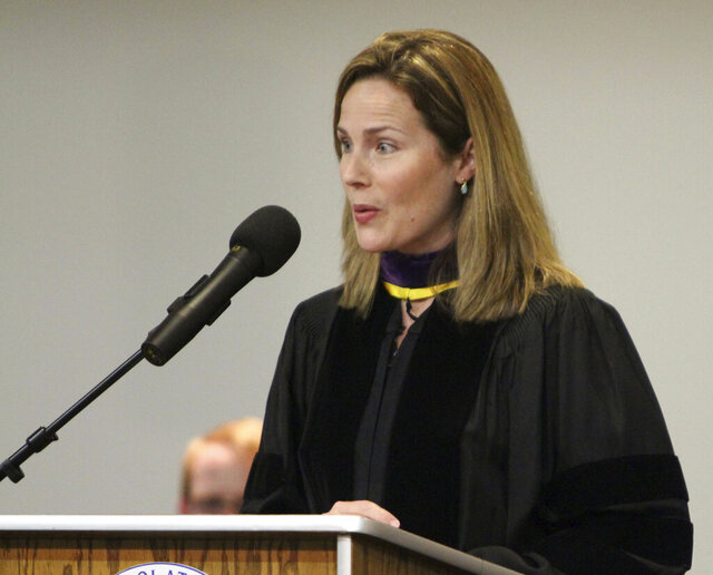 FILE - In this June 11, 2011, file photo, then-University of Notre Dame law professor Amy Coney Barrett gives the commencement address to Trinity at Greenlawn graduates at the Trinity People of Praise Center in South Bend, Ind. (Barbara Allison/South Bend Tribune via AP)