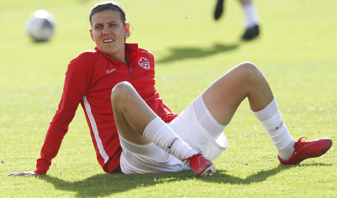 FILE - Canada's Christine Sinclair warms up before a CONCACAF women's Olympic qualifying soccer match against Jamaica in Edinburg, Texas, in this Saturday, Feb. 1, 2020, file photo. Led by new coach Bev Priestman, Canada's roster includes Christine Sinclair, the all-time top international scorer among men and women. (AP Photo/Delcia Lopez, File)