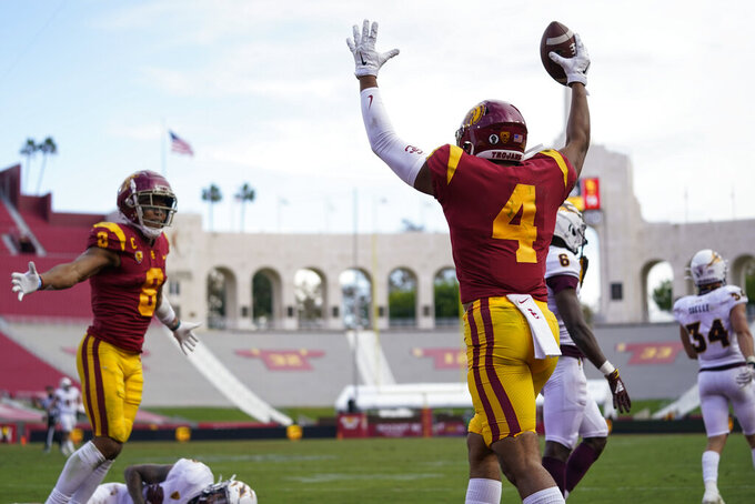 Southern California wide receiver Bru McCoy (4) celebrates after catching a deflected pass in the end zone for a touchdown against Arizona State during the second half of an NCAA college football game Saturday, Nov. 7, 2020, in Los Angeles.  (AP Photo/Ashley Landis)