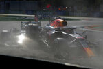 Red Bull driver Max Verstappen of the Netherlands, right and Mercedes driver Lewis Hamilton of Britain crash during the Italian Formula One Grand Prix, at Monza racetrack, in Monza, Italy, Sunday, Sept.12, 2021. (AP Photo/Luca Bruno)