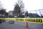The Legislative Building is seen behind caution tape and a perimeter fence, Wednesday, Jan. 20, 2021, at the Capitol in Olympia, Wash. Members of the Guard and Washington State Patrol troopers have been in place all week on the campus providing security against possible protests connected with the inauguration of President Joe Biden and the departure of former President Donald Trump in Washington, D.C. (AP Photo/Ted S. Warren)
