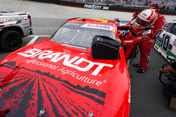 Justin Allgaier gets into his car before the NASCAR Xfinity Series auto race Friday, Sept. 18, 2020, in Bristol, Tenn. (AP Photo/Steve Helber)