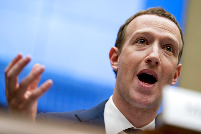 "FILE - In this April 11, 2018, file photo Facebook CEO Mark Zuckerberg testifies before a House Energy and Commerce hearing on Capitol Hill in Washington. Twitter's ban on political advertising is ratcheting up the pressure on Facebook and Zuckerberg to follow suit. Zuckerberg doubled down on Facebook's approach in a call with analysts Wednesday, Oct. 30, 2019, he reiterated Facebook's stance that ""political speech is important."