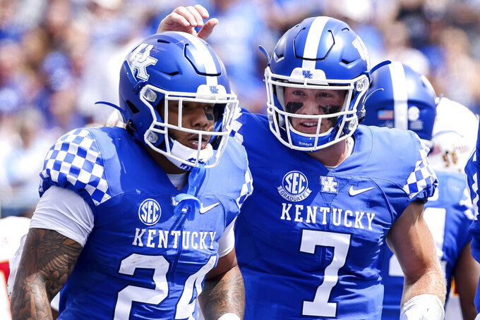 Kentucky quarterback Will Levis (7) celebrates a Chris Rodriguez Jr. (24) touchdown during the first half of an NCAA college football game against Louisiana-Monroe in Lexington, Ky., Saturday, Sept. 4, 2021. (AP Photo/Michael Clubb)