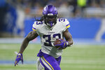 FILE - In this Oct. 20, 2019, file photo, Minnesota Vikings running back Dalvin Cook rushes during the second half of an NFL football game against the Detroit Lions, in Detroit. The Vikings have centered their offense around running back Dalvin Cook and praised him at every turn, but now the bill has come due. Cook is holding out of team activities until he has a new contract.(AP Photo/Duane Burleson, File)