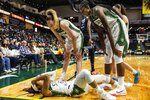 Seattle Storm's Breanna Stewart, standing left, and teammates check on Jordin Canada who was briefly shaken up while chasing down a loose ball in the first quarter of the team's WNBA basketball game against the Chicago Sky on Friday, Aug. 27, 2021, in Everett, Wash. Canada stayed in the game. (Dean Rutz/The Seattle Times via AP)