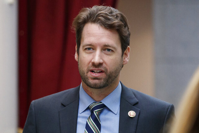 FILE - In this Jan. 4, 2019, file photo, Rep. Joe Cunningham, D-S.C., walks to a closed Democratic Caucus meeting on Capitol Hill in Washington. The candidates in South Carolina's most competitive U.S. House race debate for the first time Monday, Sept. 28, 2020.  (AP Photo/Carolyn Kaster, File)